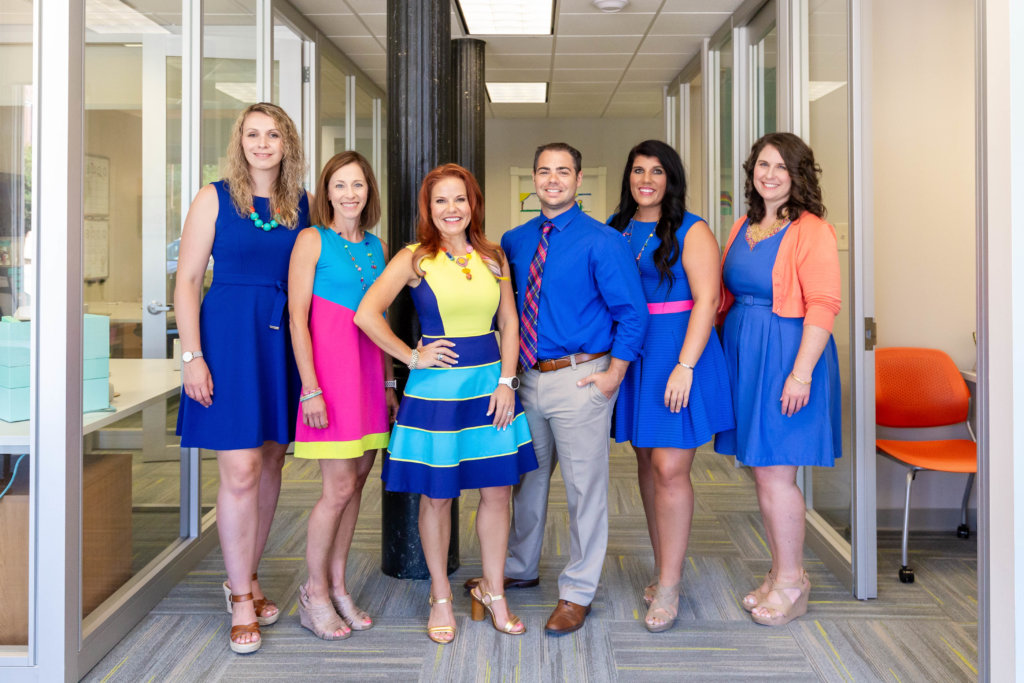 The Kim Mixon team works closely with each other to make their company successful.